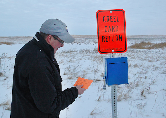 150128biologist checking creel survey box