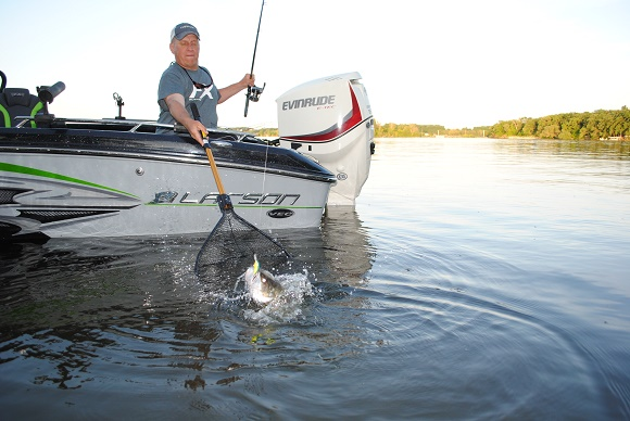 Netting your fish is a good idea for several reasons.  In this case, Mike Frisch is avoiding a crankbait that has two treble hooks.