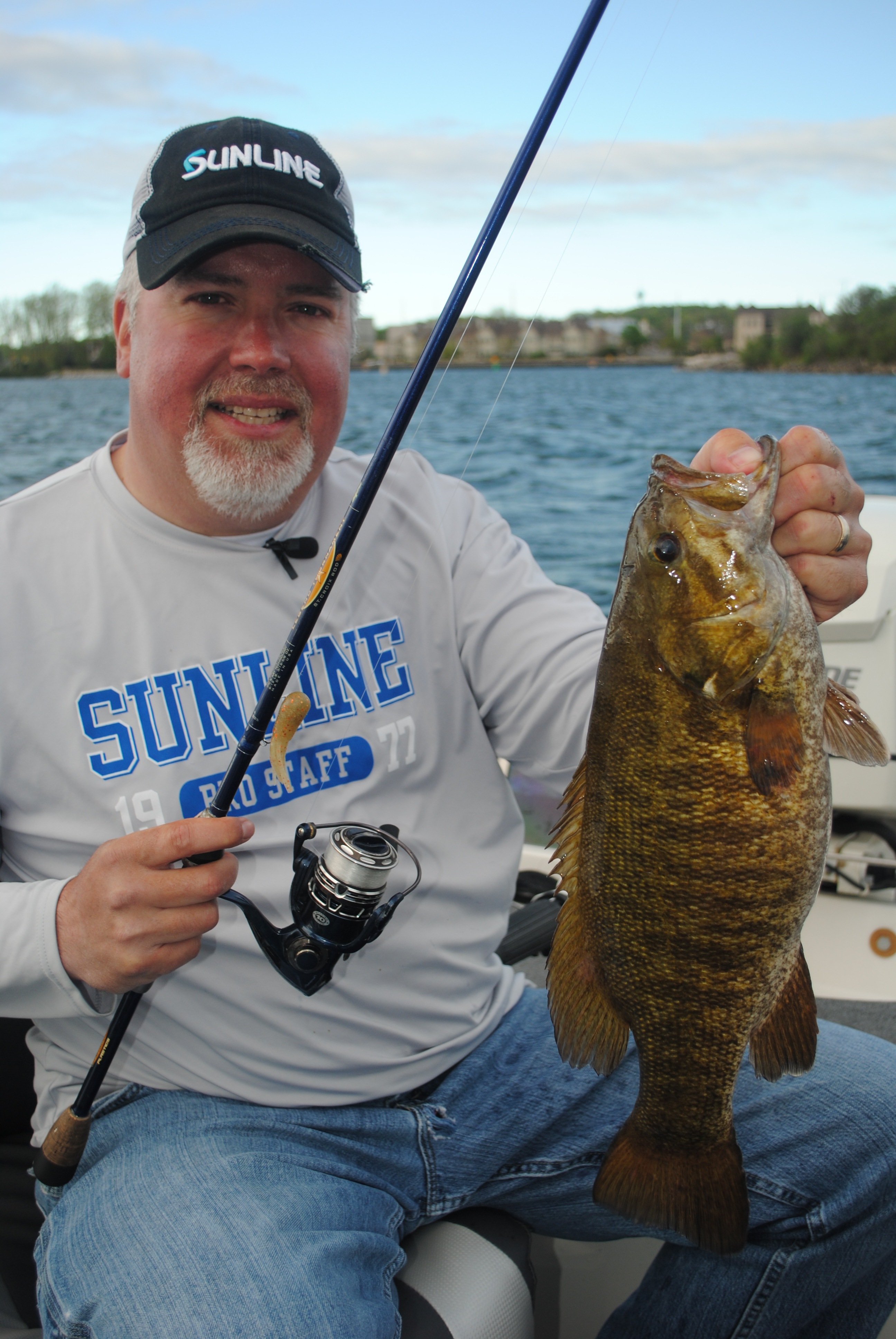 Mike Gottheardt got this smallmouth in the boat quickly with a net, then got his bait back in the water quickly in search of another bass.